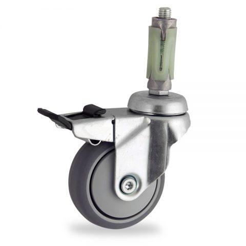 Rueda de acero galvanizado giratoria con freno 75mm  para  carros,rueda  de  goma gris elástica,eje liso.Montaje con expansivos redondo de plástico 19/23